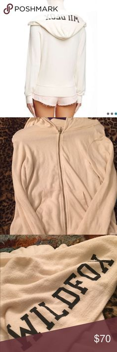 💙~WF~ Cream zip up hoodie ~WF~  Cream zip up hoodie. Just bought this and it's a little snug for a M. Very soft! It was brand new without tags! I tried it on once! Never washed or dried! It has Wildfox in black on the hood! I love it I just wish it was bigger! NO TRADES PLEASE  LISTED ON Ⓜ️ 💋Please feel free to ask me any questions you may have💋 Wildfox Sweaters Crew & Scoop Necks