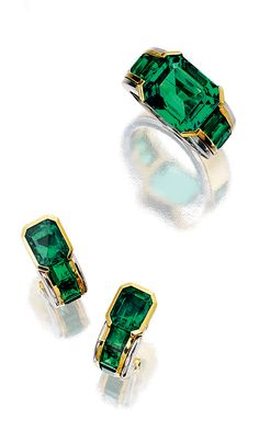 EMERALD DEMI-PARURE, HEMMERLE.  Comprising: a ring set at the centre with a cut-cornered emerald, the shoulders set with similar calibré-cut stones, size 52; together with a pair of ear clips of similar design, mounted in yellow gold and platinum, clip and post fittings, maker's marks.