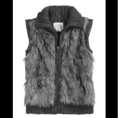 Gray Sparkling Faux Fur Vest A stunning faux fur gray vest with the perfect amount of sparkle. Vest has only been worn one time and is in excellent condition! The front is paneled in faux fur with the back being sweater material. Please note - item will not be shipped until Saturday, March 19, as I am away. *** ABSOLUTELY NO TRADES Justice Jackets & Coats Vests
