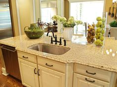 Venetian Gold Light island countertop with white/cream cabinets