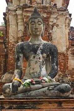 Buddha Statue in Ayyuthaya Province, Thailand by Remi Benali.