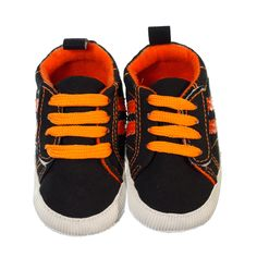 Trendy and bright pre-walker sneaker for boys. Brown shoe with bright orange laces as well as bright orange stripes on the side and bright orange lining of the shoe. Both laces and velcro strap to keep shoes on little feet. Sneakers are ankle high with a non-slip sole to provide grip to surfaces if your little one crawls, stands or takes a couple of steps. Shoes are lightweight and easy to wear.  Price: $29.95  http://www.bubbaboosh.com.au/boys-shoes/Hamish
