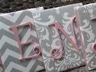 this would be super easy to make with hobby lobby letters spray painted pink and fabric background