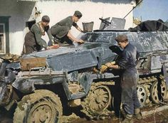 Cleaning duty. As winter gives way to summer, the winter camouflage was washed off, revealing the paled variant of the standard Panzergrau. Soviet union, date unknown  ~ Vengeance_Lord