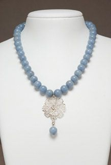 Angelite semiprecious stones necklace with Sterling Silver flower pendant.
