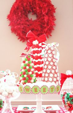 #Christmas #centerpiece with peppermints, candies and red feather boa wreath