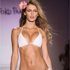 Love the long wavy beach hair & flower for this runway show at Miami Swim Week