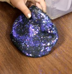 galaxy dough  2 cups of plain flour  2 cups of water with black and blue food coloring  1 Tbsp. of cooking oil  1 Tbsp. cream of tartar  1 cup of salt  Mix liquid ingredients in a large pan. Begin to heat liquids. In a separate bowl mix dry ingredients.  Add to the heating liquids.   Stir until the dough gathers and thickens.  Cook until it gets that sheen to it.  Let it cool slightly and then knead to bring proper consistency.  Store in plastic container. add glitter.
