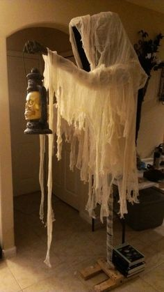 2015 Cloaked Halloween ghost with skull lantern - cheesecloth