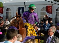 California Chrome, with jockey Victor Espinoza in the irons receives the winner's blanket of flowers after winning the second leg of Thoroughbred racing's Triple Crown with his win in the 139th running of The Preakness Stakes Saturday evening May 17, 2014 at Pimlico Race Course in Baltimore, Maryland. Standing with California Chrome is trainer Art Sherman, lower right. (Skip Dickstein Photo) Pimlico Race Course, Preakness Stakes, Photo Store, Baltimore Maryland, Horse Photos, Thoroughbred, Irons, Derby, Chrome