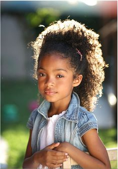 Adorable little girl with beautiful natural hair