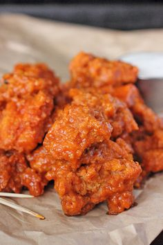Garlic Buffalo Boneless Wings  --  chicken breast chunks are floured and fried then coated with a garlicy hot sauce.