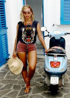 Seen on Celebrity Style Guide: Beyonce Knowles wearing Wildcat Tee by Lovers + Friends, Topshop Moto Red Leopard Print Hotpants, Tumblr Pic September 9 2013
