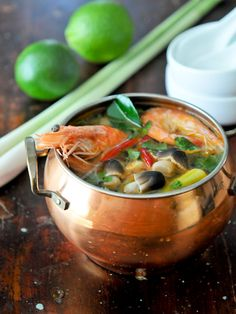 Tom Yum Goong ต้มยำกุ้ง - Commonly known as the most popular dish in Thailand, this spicy shrimp soup is a favorite among Thais. The soup often includes shrimp, mushrooms, tomatoes, lemongrass, galangal and kaffir lime leaves giving it a wonderful aroma. Yum!