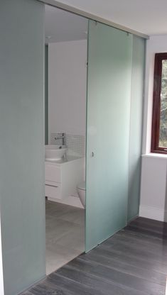 This sliding glass door idea would be excellent for the en-suite toilet - let's light in but hides