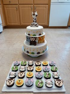 Jungle Baby Shower cake and cupcakes, via Flickr.