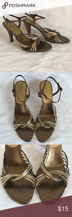 "{Bandolino} Metallic Strappy Heeled Sandal These gorgeous metallic sandals go with any outfit! They are very neutral but add just the right amount of detail to your outfit! They are comfortable and have an ankle strap for security. They come with a box but not their original box. They have a comfortable 3 1/2"" heel. Shoes wear and tear, please reference all pics. Bandolino Shoes Sandals"