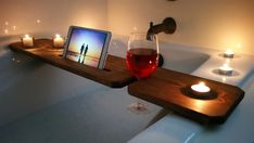 This bath tub tray is a must have for bath time! The tray is capable of holding a smart phone/tablet, wine glass and two candles (up to 2 inches in diameter)! This tray is stained dark honey and finished with water resistant coating to help prevent water soaking into the wood! Tray