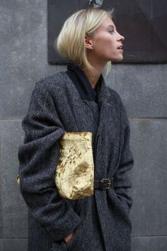 Street style, model off duty, gold velvet clutch, Isabel Marant belted chevron coat