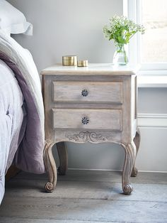 Beautifully hand carved from mango wood, our elegant French-inspired furniture includes intricate carved details with a limewashed finish. Our Loire Bedside Table includes four curved legs and two drawers with rustic iron knobs; perfect for bedside your bed. This beautiful bedside accessory adds romantic French style to your space; team two together either side of your bed for the complete look.