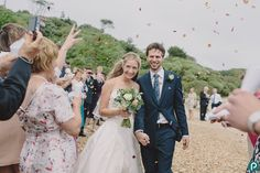 The Bride & Groom confetti photo taken on Highcliffe Castle beach in Dorset. Reportage and documentary wedding photography by Dorset wedding photographer and photojournalist.