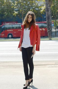 Red leather jacket + white tee + black jeans + pumps. Casual fashion.