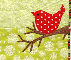 "red bird wall quilt for Christmas, winter- ""Merry Bird"" in bright red on lime and white. $48.00, via Etsy."