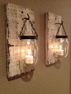 Splendid Rustic barn candle holders from mason jars. On Etsy but not challenging to make. The post Rustic barn candle holders from mason jars. On Etsy but not challenging t . Mason Jar Candle Holders, Mason Jar Candles, Mason Jar Crafts, Citronella Candles, Pot Mason, Wall Candle Holders, Mason Jar Wall Sconce, Mason Jar Chandelier, Rustic Candle Holders