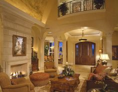 warm color scheme. not the rounded ceilings, and darken the fireplace.