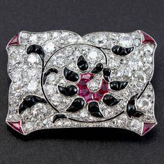 1920s Art Deco Ruby Onyx Diamond Platinum Canvas Brooch.