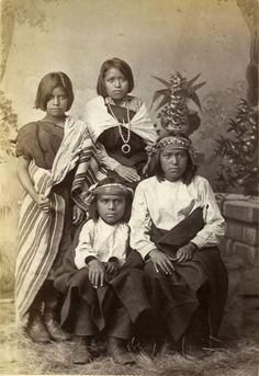 Four Pueblo children from Zuni, N.M., c. 1880.