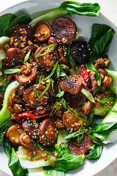 Glazed Shiitakes With Bok Choy - NYT Cooking: Gorgeous glazed shiitake mushrooms and tender green bok choy sparked with ginger, sesame and hot pepper. They also are delicious draped over a pile of rice. Vegan Vegetarian, Vegetarian Recipes, Cooking Recipes, Healthy Recipes, Cooking Tools, Kid Cooking, Skillet Recipes, Cooking Videos, Recipes
