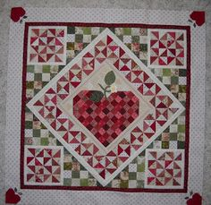 "I love this pieced (with some applique) quilted project named ""Love Grows"" from emptynestnightmare.blogspot.com"