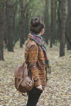 Vintage boho jacket, floral scarf and a brown backpack.