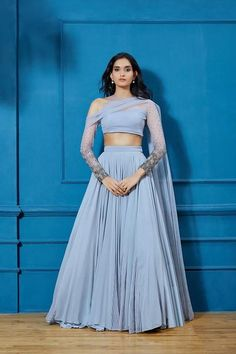 Gray Embellished Lehenga Bluish Gray georgette lehenga w/ net pintucked godets & one cold shoulder full sleeve net & georgette blouse w/ attached net embellished dupatta drape Fabric: Georgette, Net, Santone Indian Fashion Dresses, Indian Gowns Dresses, Dress Indian Style, Indian Designer Outfits, Designer Dresses, Choli Designs, Lehenga Designs, Indian Lehenga, Lehenga Choli
