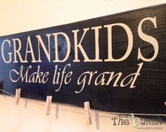 Grandkids Make life grand--- wood sign photo holder wall hanging.  Clothes pins clip with photo to Jute String to show off the kiddos! by the bunch #ChristmasGift #Grandkids #Grandparent