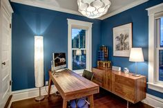 The office is resplendent in blue (Georgian Bay by Sherwin-Williams).  Desk: Dania; credenza: Room & Board