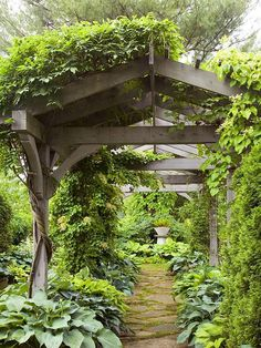 pergola with peaked roof. Must have for my back pathway