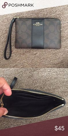 Brown and Black Coach Signature Wristlet Brown Coach wristlet with signature print and black leather stripe down the center. It can fit an IPhone 5s and has two card slots inside Coach Bags Clutches & Wristlets