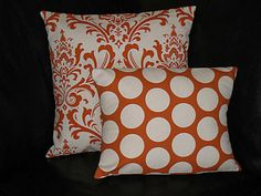 Pillow Covers ORANGE Decorative Throw Pillows Two 18 x 18 inches Mix & Match Designer Fabric FRONT and BACK sweet potato, brown, blue, ivory. $30.00, via Etsy.