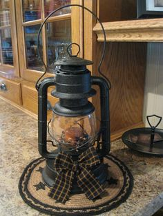 Dollar store lantern, spray paint it add country candle some berries and a plaid bow , Voila !