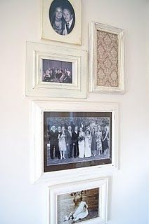 Family pictures on the wall.  Love the pretty white frames.  Dining Room