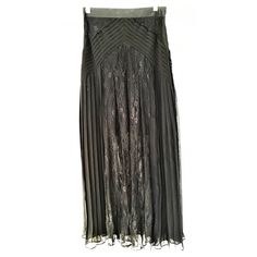 Black lace maxi skirt Lace maxi skirt with side pleats and cummerbund detail.  Sits mid-waist and has a side zipper.  Short solid slip underneath sits above the knee so leg is mostly sheer.  So cute with heels or booties, looks great with sandals and flats too! Skirts Maxi