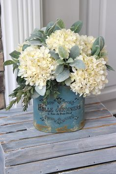 Farmhouse Decor~ Hydrangea Centerpiece~All Year Round Arrangement~Hydrangeas and Lambs Ear in a Blue Metal Pail Basket Flower Arrangements, Hydrangea Arrangements, Artificial Floral Arrangements, Artificial Flowers, Wedding Arrangements, White Hydrangea Centerpieces, Round Table Centerpieces, Table Decorations, Wedding Centerpieces