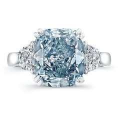 as an ice-blue diamond encircled by white diamonds and set off by a simple band.