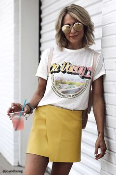 "A slub knit tee featuring a crew neck, short cuffed sleeves, ""On Vacay"" front graphic print atop a cactus landscape graphic, framed with a ""Enjoy This Moment For This Moment Is Your Life"" text."