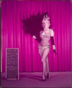 "Marilyn in the original costume for the ""Diamonds are a Girl's Best Friend"" number in Gentlemen Prefer Blondes. After the discovery of her nude calendar, this outfit was deemed too revealing by the studio and designer William Travilla came up with..."