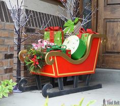 """Build a cheery DIY Santa's Sleigh out of 3/4"""" plywood for your Christmas decor. Fill the sleigh with presents of use as a photo prop."""