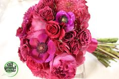 Hot pink bridal bouquet with dahlia, anemone, garden roses and spray roses. Make by All Grand Events in East Lansing, MI.