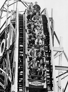 Loaded to capacity, Coney Island's Cyclone roller coaster starts a downhill plunge, April 7, 1963 in New York City amusement park opening day of the 1963 season. Note carefree no-hands style of boys in the front seat of the speeding three-car conveyance. (AP Photo)